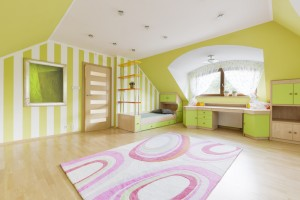 Green room with striped wallpaper, bed, desk and wide window